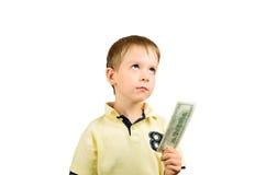 O rapaz pequeno que olha acima, toma a uma conta 100 dólares americanos Fotos de Stock