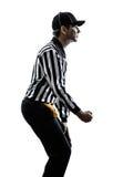 O árbitro do futebol americano gesticula a silhueta do grampeamento Imagem de Stock Royalty Free