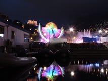 O recinto de diversão ilumina-se no porto de Mônaco com o castelo no fundo Imagem de Stock Royalty Free