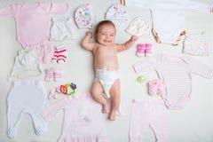 O recém-nascido com a primeira roupa Fotos de Stock Royalty Free