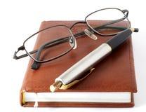 O registro diário do homem de negócios Fotografia de Stock