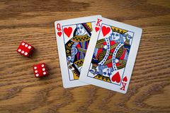 O rei e a rainha dos corações e de dois vermelhos morrem Imagem de Stock Royalty Free