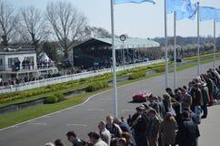 O relógio do espectador a ação da raça em Goodwood Fotografia de Stock
