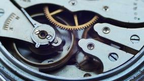 O relógio do vintage alinha o macro do movimento filme