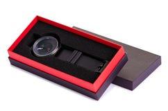 O relógio preto em uma caixa fotografia de stock