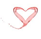 O respingo da forma da água vermelha gosta de um coração Fotografia de Stock