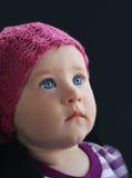 O retrato da criança no fundo preto Imagem de Stock