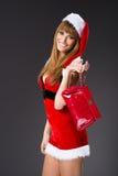 O retrato da menina 'sexy' bonita que veste Papai Noel veste-se foto de stock royalty free