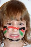 O retrato de uma menina com uma cara pintada gosta de um guerreiro Fotos de Stock Royalty Free