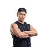 O retrato do busto do homem novo muscled está com braços dobrados Estilo de vida saudável Aptidão e esporte foto de stock royalty free