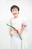 O retrato do rapaz pequeno finge como o cupido com asa Foto de Stock Royalty Free