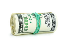 O rolo de $100 notas de banco apertou com faixa de borracha Fotografia de Stock