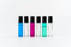O rolo de vidro engarrafa claramente e cor em seguido Fotografia de Stock Royalty Free