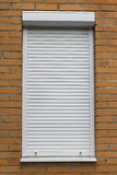 O rolo protetor do metal branco shutters na cor branca Fotografia de Stock Royalty Free