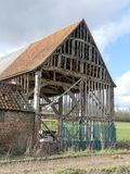 O século XVI preto do celeiro, exploração agrícola de Woodoaks, cruz do bordo fotografia de stock