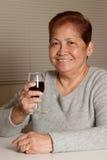 O sénior tem o vinho Foto de Stock Royalty Free