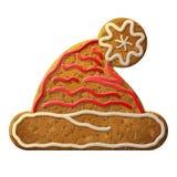 O símbolo do chapéu de Santa do pão-de-espécie decorou a crosta de gelo colorida Imagens de Stock Royalty Free