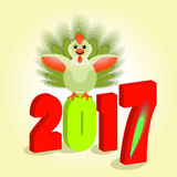 O símbolo representa um galo novo com as penas esverdeia, cauda macia dois mil décimas sétimas figuras de 2017 volumes Fotos de Stock