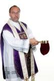 O sacerdote católico coleta Imagem de Stock Royalty Free