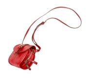 O saco de couro fêmea vermelho cai no ar Foto de Stock Royalty Free