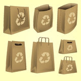 O saco de papel com recicl o vetor do logotipo Imagem de Stock Royalty Free