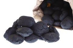 O saco, saco isolou o carvão, pepitas do carbono Imagem de Stock