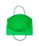 O saco verde do presente cai através do ar Fotos de Stock Royalty Free