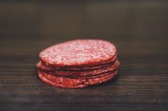 O salame corta a pilha Fotos de Stock