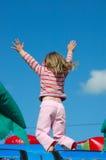 O salto da menina Foto de Stock Royalty Free