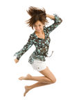 O salto da menina da alegria sobre o branco imagens de stock
