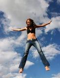 O salto da mulher da alegria fotografia de stock royalty free