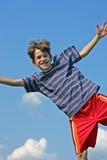 O salto do menino Imagem de Stock Royalty Free