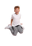 O salto do menino Imagens de Stock