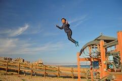 O salto do menino Fotos de Stock Royalty Free