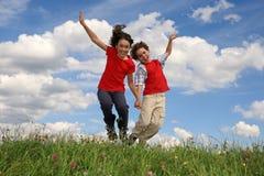 O salto dos miúdos Imagem de Stock Royalty Free