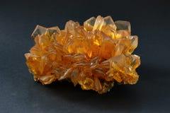 O selenito alaranjado Crystal Cluster, igualmente conhecido como o espato do cetim, deserto aumentou, ou flor da gipsita imagens de stock royalty free