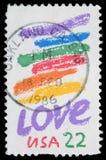 O selo impresso nos EUA mostra a imagem do dedicado ao amor fotografia de stock