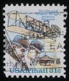 O selo imprimiu nos EUA que mostram irmãos e Wright Flyer que de Wright eu aplano Foto de Stock Royalty Free