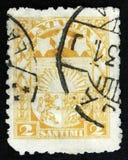 O selo letão mostra os braços e as estrelas para Vidzeme, Kurzeme e Latgale, cerca de 1931 Fotos de Stock