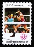 O selo postal de Cuba mostra o encaixotamento, série devotada aos jogos de Montreal 1976, cerca de 1976 Fotografia de Stock