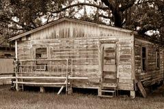 O Sepia tonificou a casa velha com embarcado acima da porta Imagem de Stock Royalty Free