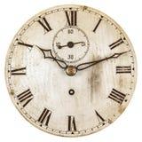 O Sepia tonificou a imagem de uma face do relógio velha fotos de stock