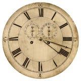 O Sepia tonificou a imagem de uma face do relógio velha isolada no branco foto de stock