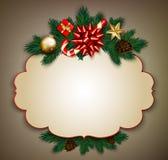 O sinal da venda do Natal do vintage com abeto ramifica, curva do cetim, doces Fotografia de Stock