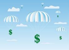 O sinal de dólares vai para baixo em um pára-quedas Imagens de Stock Royalty Free