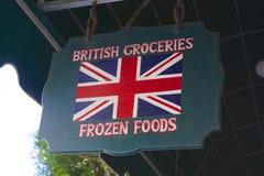 Sinal britânico do quitandeiro Fotografia de Stock Royalty Free
