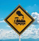 O sinal de tráfego beware o trem fotos de stock