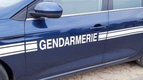 O sinal do Gendarmerie é polícia francesa isolada em um carro fotos de stock royalty free