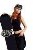 O snowboarder da mulher nos óculos de proteção Fotografia de Stock Royalty Free