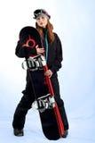 O snowboarder das mulheres nos óculos de proteção Imagens de Stock Royalty Free